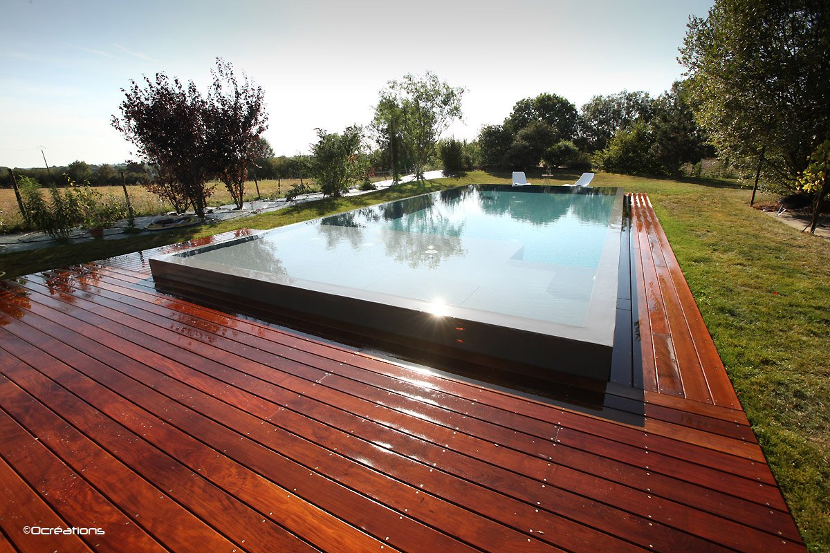 Piscine d bordement en bois for Piscine a debordement kit